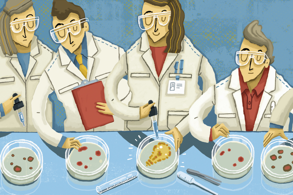 Four scientists in white lab coats with petri dishes