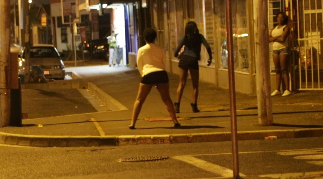 Three female sex workers waiting on a street in Johannesburg, South Africa