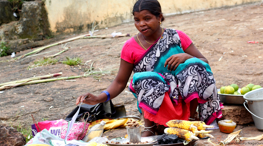 Butta girl with bamboo chicken at Araku Valley. Andhra Pradesh