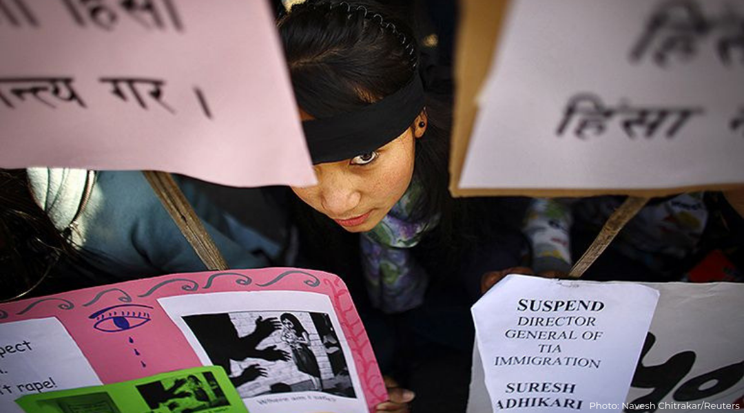 A Nepalese woman takes part in a protest demanding stronger laws that protect women against physical and sexual abuse