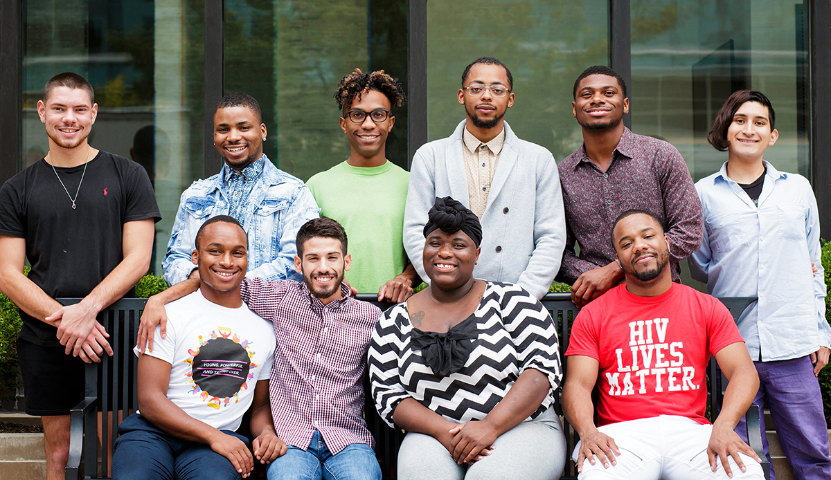 Diverse group of young people posing and smiling for National Youth HIV/AIDS Awareness Day