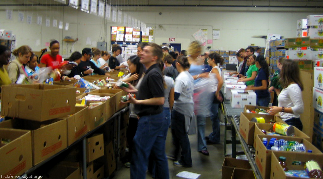 motion blurred photo of people sorting food at food bank