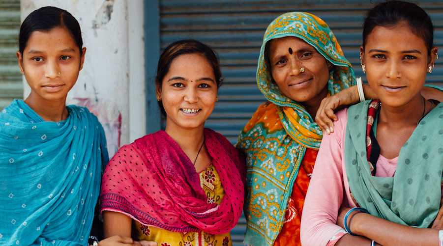 A family of four Indian women standing together